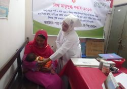 A woman breastfeeds at the breastfeeding corner at Abhaynagar upazila Health Complex