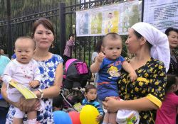 Mothers and infants participating in the Kara Kul town World Breastfeeding Week event.