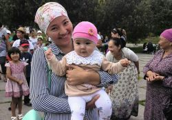 A mother and her infant at the Kara Kul town awareness event.