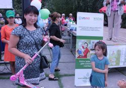 A mother in Kara Kul with her daughter, who won a drawing contest as part of the celebration event.
