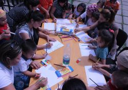 Participants in the World Breastfeeding Week event take part in a drawing contest about healthy families.