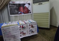 SPRING's booth displaying IYCF materials.
