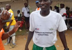 The winner of the 1st Bushenyi Nutrition 21km, proudly dressed in SPRING-provided T-shirt!
