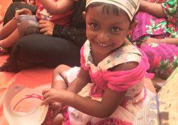 A young girl celebrates World Breastfeeding Week