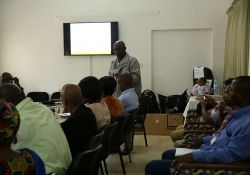 Dr. Mamy Keita, Agriculture Specialist, USAID Guinea, gives opening remarks on SPRING's SBCC in Guinea.