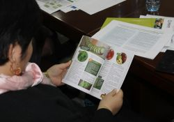 A participant looks at a copy of the new publication for home-based storage and preservation of nutritious foods in the Kyrgyz Republic.