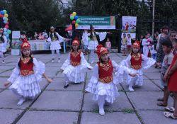 "Local dance group ""Jash Kiyal"" performs traditional dances as part of SPRING's World Breastfeeding Week event in Kara Kul."