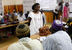 SPRING/Senegal Gender Advisor Daba Ndione Beye interacts with training participants.