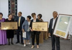Elmira Imambakiyeva, USAID Project Management Specialist, Madhwaraj Ballal, SPRING Chief of Party, and Murat Aliaskarov, Naryn Oblast Health Coordinator, award representatives from Ak-Talaa Territorial Hospital and Family Medicine Center with plaques to certify their health facilities as Mother-baby friendly.
