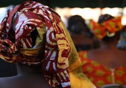 A woman looks on during the Malaria Day events in Dinguiraye.