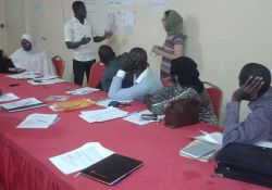 Facilitators prepare for video concept testing in Niger. Prior to working with community members, facilitators develop scenarios that include facts and benefits to encourage uptake of the desired hygiene and nutrition behaviors.