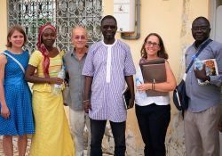"SPRING's Kate Litvin, Mariam Sy, and Bob de Wolfe pose with Alioune Badara Fall of the regional governmental agency ""Cellule de lutte contre la malnutrition"" (Unit of the Fight Against Malnutrition), along with Megan Kyles of USAID."