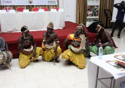 A cultural troupe performing traditional music and dance at the event.