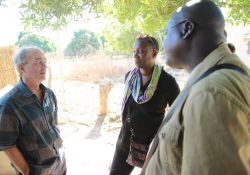 SPRING/Senegal Chief of Party- Bob de Wolfe, SPRING Director of Country Initiatives- Altrena Mukuria, and SPRING/Senegal Agriculture Advisor- Aliou Babou discuss next steps for the chicken-raising activity.