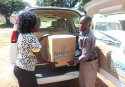 Micronutrient powders (MNP) being delivered at the health facility for distribution. SPRING delivered over 600 boxes – around two million one-gram sachets – of MNP to health facilities in Namutumba district from February to December 2016.