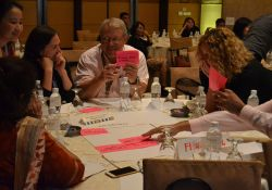 Rolf Klemm discusses with his table during a group work exercise.