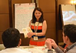 Nazgul Abazbekova presents SPRING/Kyrgyz Republic's dietary diversity cookbook during the Knowledge Cafe.