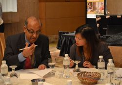 """Elaine Gray and Purushottam Mainali discuss group work during """"Introduction to Multi-Sectoral Programming, Collaboration, and Coordination."""""""