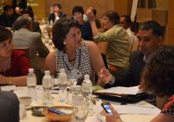 Carolyn Hart and Debendra Adhikari discuss group work on multi-sectoral programming.