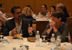 """Vamsidhar Reddy and Carolyn O'Donnell discuss group work on """"Introduction to Multi-Sectoral Programming, Collaboration, and Coordination."""""""