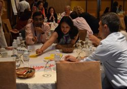 Arif Rashid and Pooja Pandey Rana prioritize behaviors to promote based on anticipated feasibility and impact during a group work session.