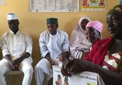 Community Volunteers (CVs) from Kajuru ward in Kajuru LGA, including these men from Ruga Ardo Suleiman Community, a Fulani settlement, attend a monthly review meeting. During this meeting CVs shared stories of women struggling to deliver the placenta after birth and successfully doing so after the CVs encouraged the mother to breastfeed immediately. Several CVs also mentioned different endeavors of support groups to encourage new practices, save money, and even make money.