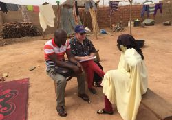 Dr. Rafael Pérez-Escamilla, SPRING consultant and Principal Investigator of the Evaluation of C-IYCF in Kaduna State, interviews a grandmother who has been participating in support group meetings for several months. Dr. Pérez-Escamilla was assisted by Mr. Ango, Kajuru LGA Nutrition Focal Person.