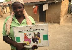 Mrs. Agatha Timothy, a C-IYCF Community Volunteer for Idon ward in Kajuru LGA shows her copy of the C-IYCF Counseling Cards. She has really enjoyed serving her community and has received support from the village chief, who lends his home for support group meetings.