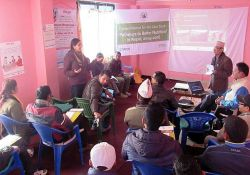 PBN Nepal team members Monica Biradavolu and Madhukar B. Shrestha present final district findings in Achham