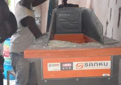A miller at Family Choice Maize Millers uses a Sanku machine to fortify grain.