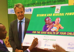 Dr. Boyo signs the commemorative micronutrient powder sachet (Photo credit Abel Muzoora).