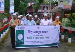 A banner is walked through Patuakhali district during a World Breastfeeding Week rally