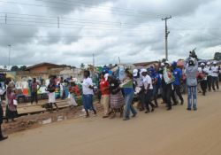Participants dancing and disseminating IYCF flyers at Kuje Market, FCT