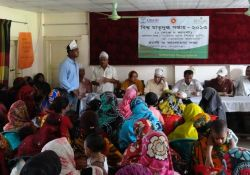 Mothers share stories during a meeting with local administrative officers