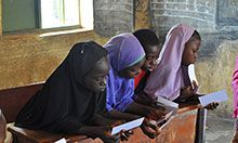Adolescent girls aged 12-17 review illustrations conveying information on dietary diversity during concept testing for nutrition and hygiene activities included in a training package geared towards OVCs.