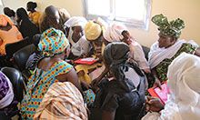 Members of a hygiene monitoring unit in Keur Socé, in Kaolack Department work on their action-plan to for how they will monitor hygiene in their communities.
