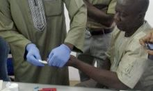 A health worker uses a hemocue on a patient.