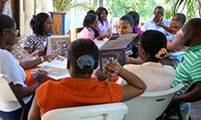 Health care workers practice using counseling cards during training. Source: Nicole Racine, SPRING.