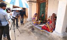 Filming a group of women practicing healthy food preparation