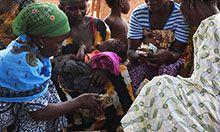 Two women exchange cash