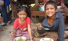 Happy children eating a meal