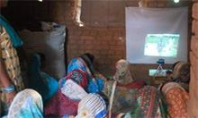Photo of women watching a video indoors