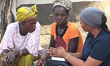 Cécile Ndiaye (right) speaks with two training participants.