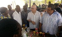 U.S. Ambassador Jackson engages with Kasuliyili CHPS Compound staff on available health services.
