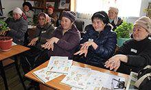 A group of women attending a handwashing seminar.