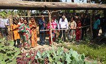 The delegation views a community garden
