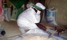 Mixing fortificant with maize flour.