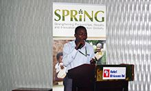 Photo: SPRING staff member Mike Mazinga presents on the current status of maize milling in Uganda.