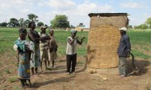 Group of people around a latrine