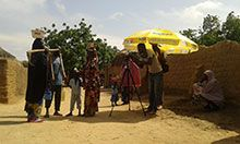 Videographers film a scene in the Sahel